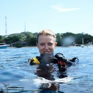 Photo of Sara in the ocean wearing diving gear.